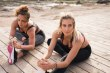 Attractive healthy women doing stretches outside