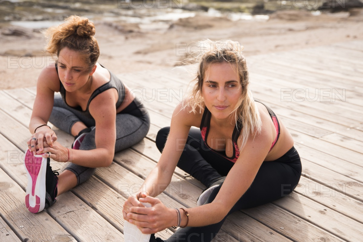 Attractive healthy women doing stretches outside stock photo