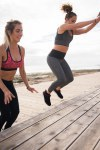 Attractive happy young women doing sports