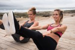 Pretty smiling women in excercise clothes
