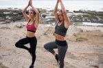 Two pretty fit young women doing yoga