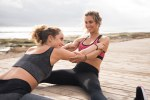 Young healthy women doing stretches outside