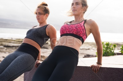 Attractive young exercising women looking strong