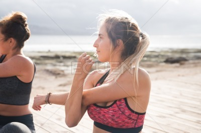Blonde girl exercising on a sunny day