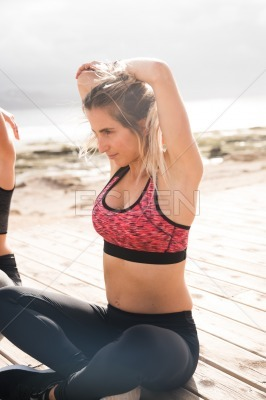 Pretty young blonde in modern fitness clothes