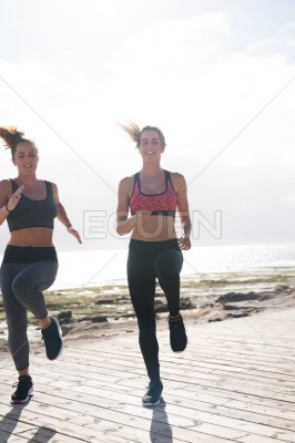 Pretty young sporty women doing cardio