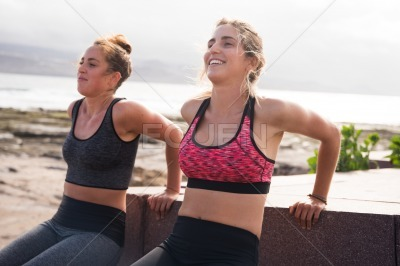 Pretty young sporty women exercising together