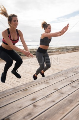 Sporty girls exercising on promenade stairs