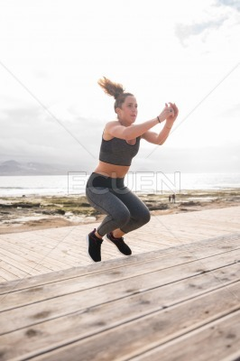 Sporty young woman doing fitness training