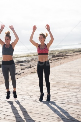 Sporty young women getting fit together