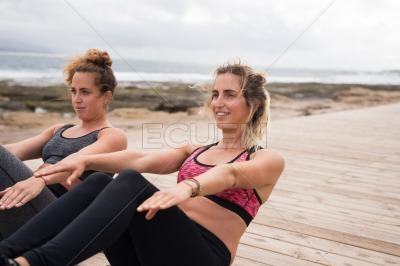 Two beautiful young women in excercise clothes