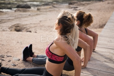 Two young women doing fitness exercises
