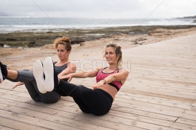 Young beautiful girls doing fitness training