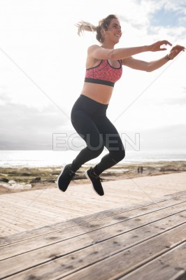 Young pretty blonde jumping in the air