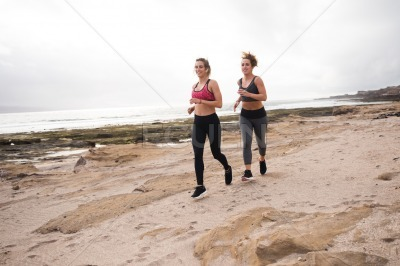 Young sporty women getting fit together