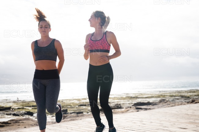Attractive brunette and blonde getting fit stock photo