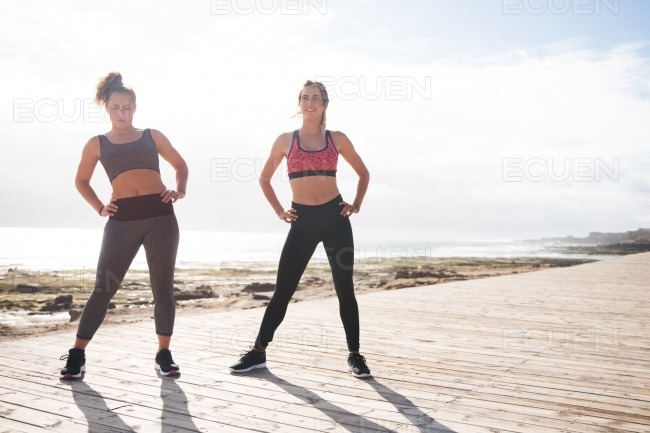 Beautiful young women getting fit together stock photo
