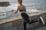 Back view of a woman exercising by the sea