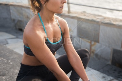 A fit looking young woman in tights and tank top