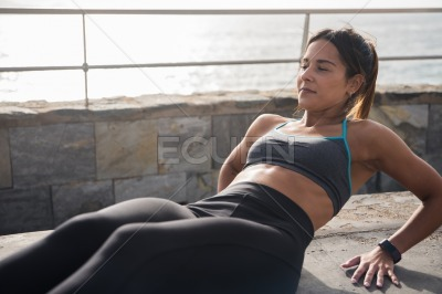 A fit young woman doing stomach crunches