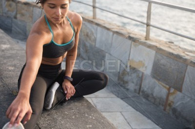 An attractive woman exercising on the promenade
