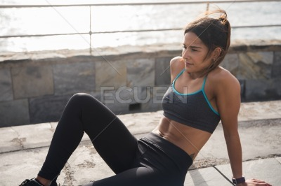 Attractive young woman in fitness clothes