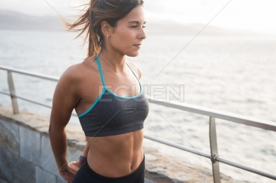 Pretty sporty woman in exercise clothing