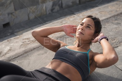 Strong young brunette doing fitness training