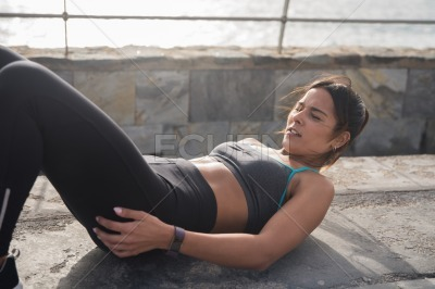 Young focused brunette working out outside