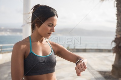 Young pretty brunette looking at her watch