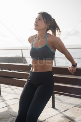Young sporty woman doing fitness training outside