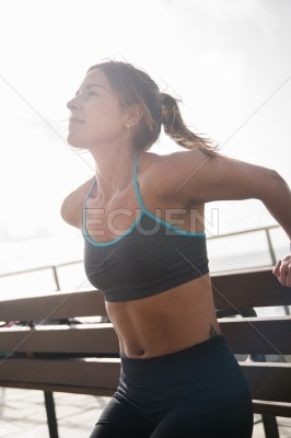Young woman exercising on a sunny day