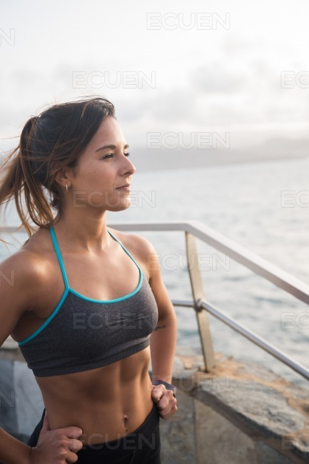 A pretty young woman in sports clothing stock photo