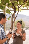 A man and woman having a glass of red wine