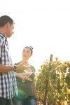 A young man and woman chatting in the vineyards