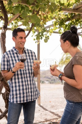 A couple in casual clothing having wine
