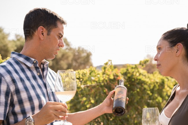 A man and woman talking over a bottle of wine