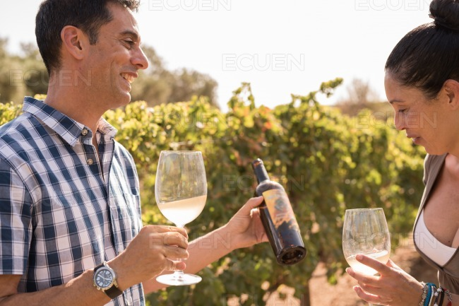 A young woman and man drinking wine