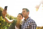 Woman taking a photo of herself and a man