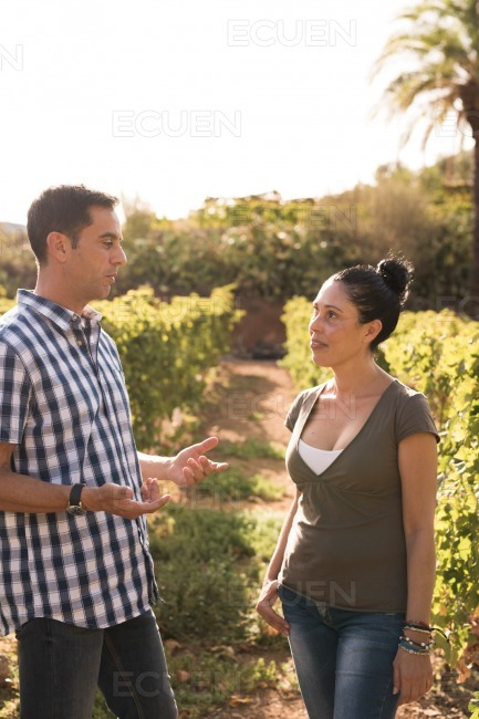 Brown haired man and woman having a conversation