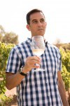 Man holding a glass of wine outdoors