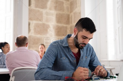 Man sitting at a desk concentrating on a job