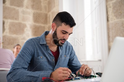 Man sitting at a desk working