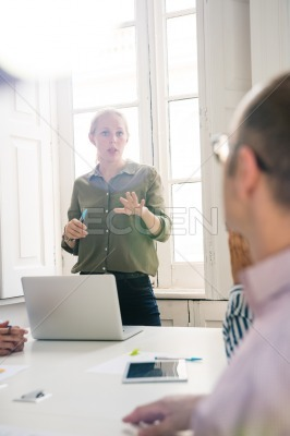 Woman in an office giving a presentation