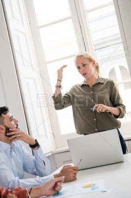 Woman standing in front of a computer talking