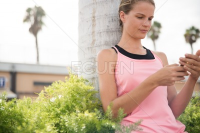 Young woman looking at her phone