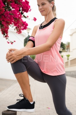Young woman with her leg up stretching her leg