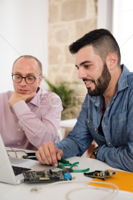 Two business men looking at a computer