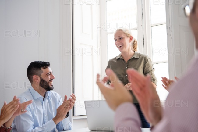 Woman laughing in acknowledgment of the applause stock photo