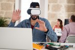 Man in an office wearing virtual reality glasses